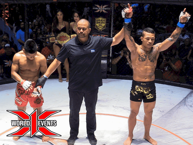 Ricky Camp from Guam defeats Rodney Mondala from Oahu at First Round 3:52seconds